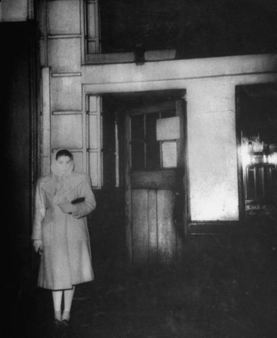 17-19 Great Windmill Street 1944 February - Girl waiting outside the stagedoor of Windmill Theatre for a friend.jpg